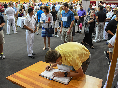 Image of a new cadet signing the Matriculation Book