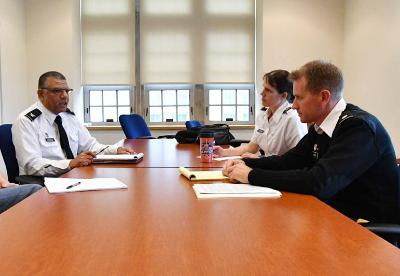 Maj. Jennifer Gerow and Lt. Col. Spencer Bakich confer with Col. Mohamed Eltoweissy on the cybersecurity minor. – VMI Photo by Kelly Nye.