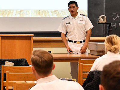 Sebastian Chavez '17 describes the milkshake business to Maj. Dee Mornah's entrepreneurship class as his business partner, Anthony Izzo '17, looks on. – VMI Photo by Kelly Nye.
