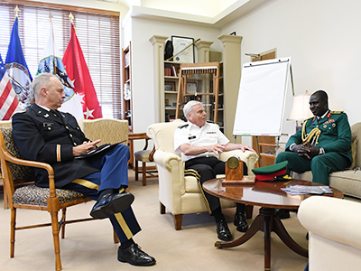 Image of Nigerian army chief of staff talking with Gen. Peay in his office