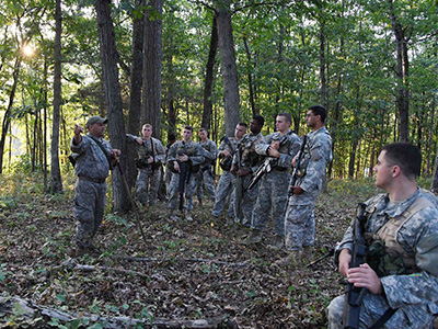 Sgt. 1st Class Carmelo Echevarria gives instructions before the night ambush begins.