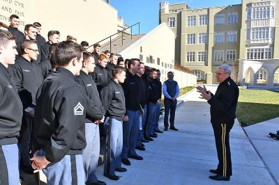 Gen. J.H. Binford Peay congratulates the rugby team in Memorial Garden.