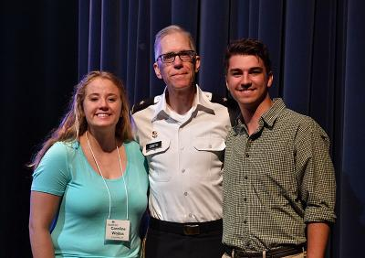 Two cadets pause with VMI's dean at the Shepherd Symposium.