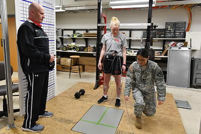 Col. Mike Krackow and Maj. Joyce Blandino show Jamie Foster '20 how to lunge forward onto the force plate to measure her muscular electrical impulses in Nichols Engineering Building March 6.