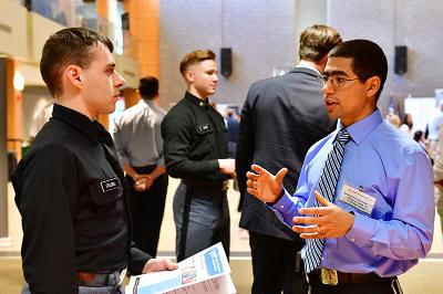 Alexander Alvarado speaks to Holden Fellows '20 at the VMI career fair.