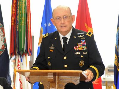 Brig. Gen. Mike Bissell '61 speaks during a ceremony honoring VMI alumni who are recipients of the Distinguished Service Cross.—VMI File Photo by Kevin Remington.