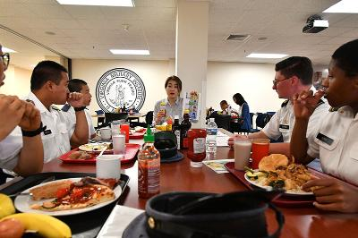 Dr. Youna Jung leads a discussion on Korean currency during lunch in Crozet Hall Sept. 18.—VMI Photo by Kelly Nye.