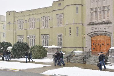 Cadets walk through the snow to class.